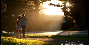 Photograph of couple kissing and walking in beautiful golden light in the Presidio