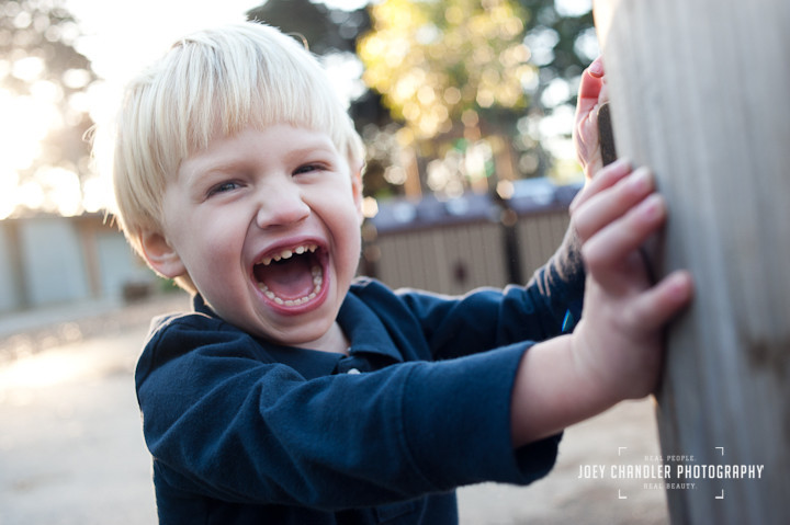 Boy laughing at Robhill in the Presidio - San Francisco Photographer Joey Chandler