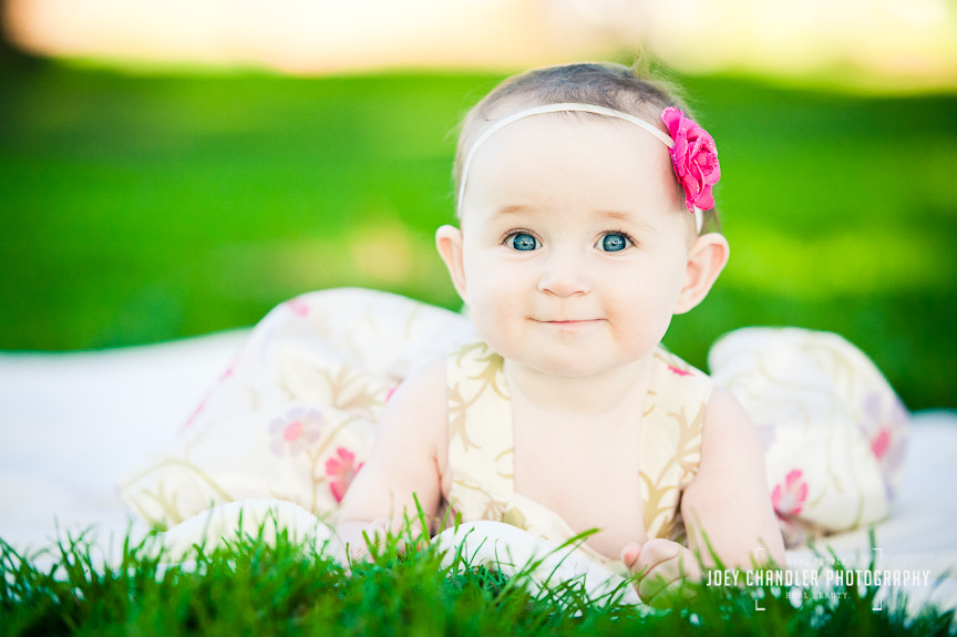 Beautiful Baby lying in the Green Grass of Sutro Heights Park - San Francisco Wedding Photographer Joey Chandler