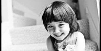 Girl smiling in San Francisco home - San Francisco Child Photography