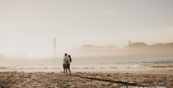 Couple kissing near the San Francisco Bay and the Golden Gate Bridge - San Francisco engagement and wedding photographer Joey Chandler