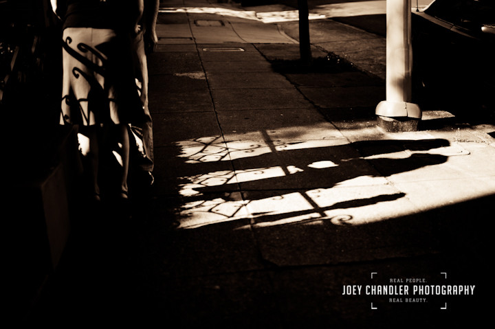 Shadow of a kissing couple on a San Francisco Street - San Francisco engagement and wedding photographer Joey Chandler