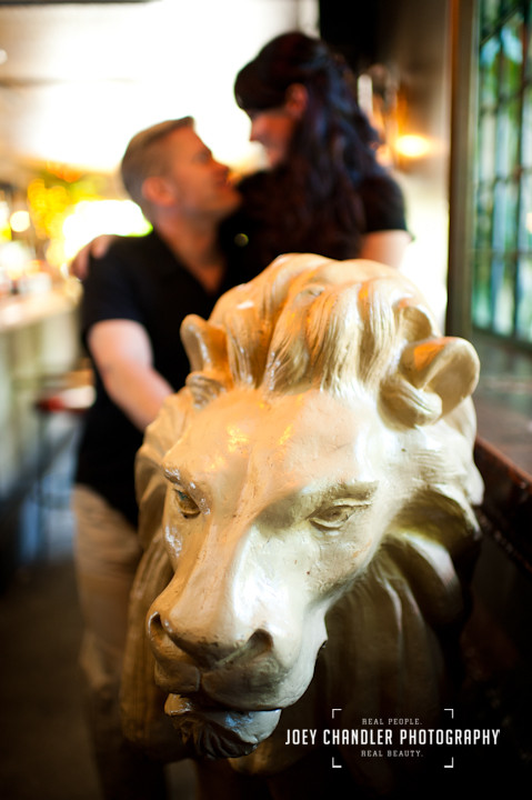 Couple sitting on the Lion at Lion's Pub in San Francisco- San Francisco engagement and wedding photographer Joey Chandler
