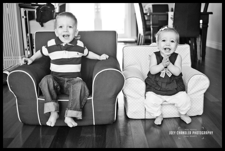 Bother and Sister sitting chairs for family photographs