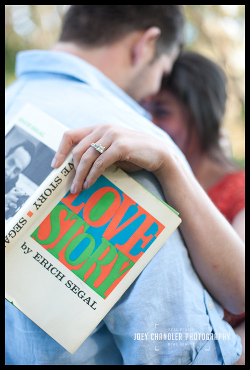 Engagement Photograph of couple with E Segal's Love Story