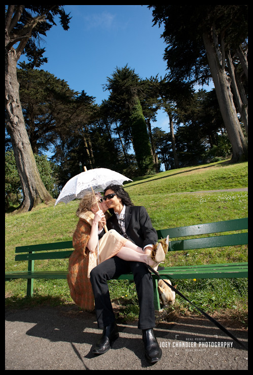Wedding couple in Alamo square with parasol