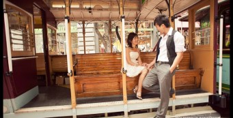 An engaged couple sitting in a San Francisco Cable Car