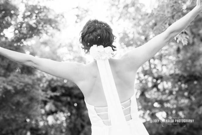 Bride happy with outstretched arms