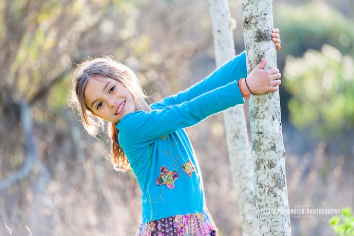 Girl leaning from a tree in a San Rafael Park