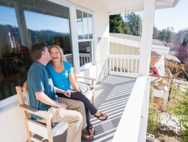 Marin couple smiling on porch in San Rafael
